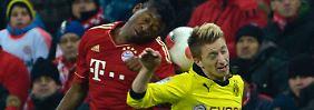 Und wo ist der Ball: Dortmunds Marko Reus und der Münchner David Alaba bemühen sich um ihn.