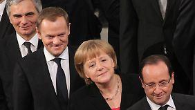 Österreichs Kanzler Werner Faymann, Polens Premier Donald Tusk, Angela Merkel und Frankreichs Präsident François Hollande bei der Verleihung des Nobelpreises.