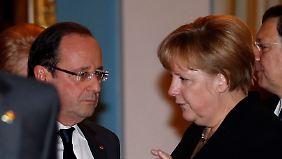 Merkel zeigt sich deutlich vorsichtiger als Hollande.