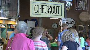 Shoppen gegen die Krise: Amerikaner stürmen Geschäfte