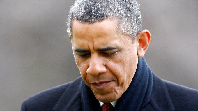 Obama bei seiner Ankunft auf dem Rasen des Weißen Hauses. Wegen des Haushaltsstreits hat der Präsident seinen Weihnachtsurlaub auf Hawaii vorzeitig abgebrochen.