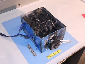 Das will niemand an Bord haben: Die US-Transportaufsichtsbehörde veröffentlichte die Aufnahme einer durchgeschmorten Dreamliner-Batterie.